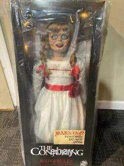 Annabelle Doll The Conjuring by Trick or Treat Studios Life Size Prop in hand