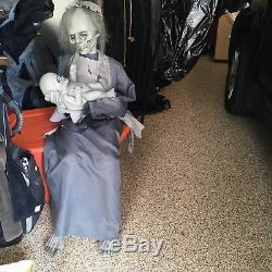 Lifesize animatronic lullaby decaying mom rocks baby for Electric motors for halloween props