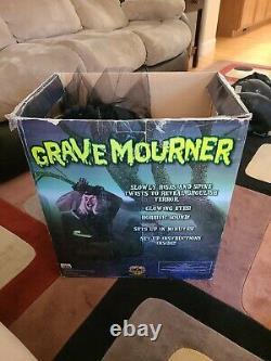 Spirit Halloween Animated grave mourner halloween prop